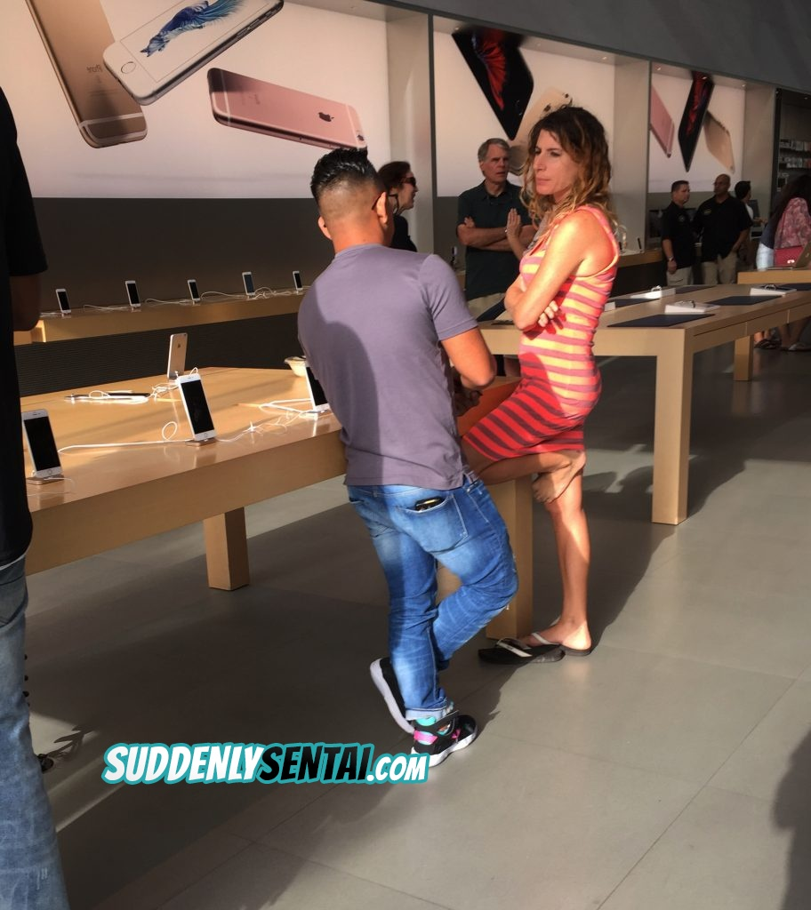 Hot milf standing and talking in apple store